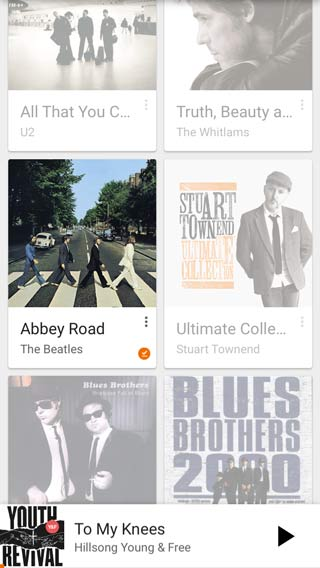 Albums that are not yet downloaded a faded. Downloaded albums are bright.